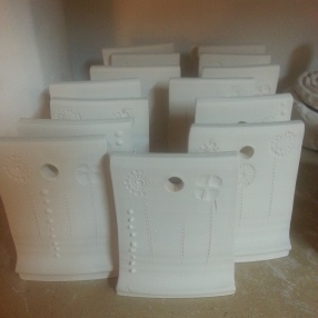 Test tiles with low relief and slip trailing.