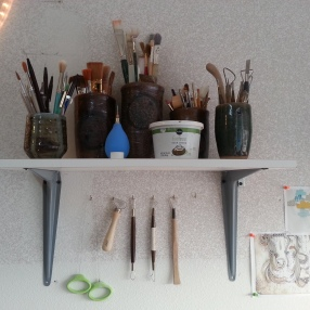 Put up a shelf and hooks to hold my tools.