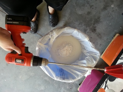 Mixing the plaster.