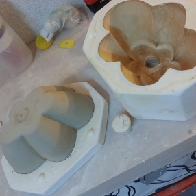 Unassembled mold with cast.