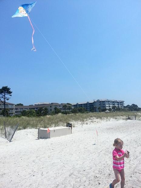 Flying a kite.